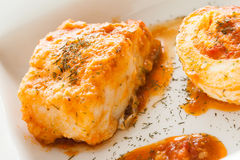 Codfish. Homemade cooked codfish with tomato sauce and boiled eggs Royalty Free Stock Images