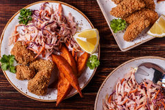 Homemade cooked сhicken nuggets, sweet potatoes and coleslaw. Royalty Free Stock Photo