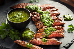 Homemade Cooked Skirt Steak with Chimichurri. Sauce and Spices Royalty Free Stock Images