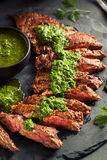 Homemade Cooked Skirt Steak with Chimichurri Royalty Free Stock Photos