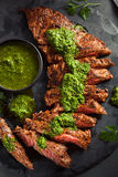 Homemade Cooked Skirt Steak with Chimichurri Stock Images