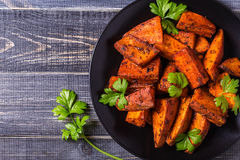 Homemade Cooked Sweet Potato with spices and herbs. royalty free stock photography