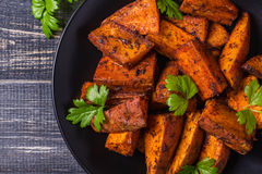 Homemade Cooked Sweet Potato with spices and herbs. royalty free stock image