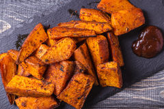 Homemade Cooked Sweet Potato with spices and herbs. Royalty Free Stock Images