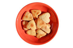 Homemade cookie hearts on a red  plate Stock Images