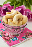 Homemade cookies. With powdered sugar and  tulips Royalty Free Stock Photos