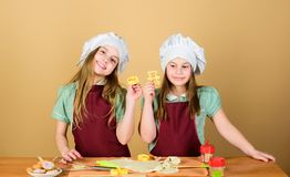 Homemade cookies best. Kids baking cookies together. Kids aprons and chef hats cooking. Family recipe. Culinary. Education. Mothers day. Baking ginger cookies stock photography