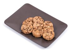 Homemade cookies on a brown ceramic platter royalty free stock images