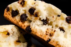 Homemade cookies with chocolate drops filling on a black background stock photo