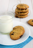 Homemade cookies with chocolate pieces and fresh milk. stock photo