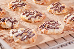 Homemade cookies with chocolate topping. On baking paper Royalty Free Stock Image