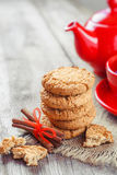 Homemade cookies, cinnamon sticks, red teakettle and tea cup Stock Photos