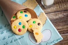 Homemade cookies with color candies in cornet. On wood background Stock Image