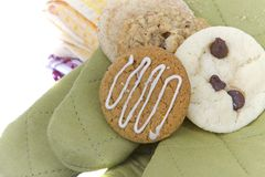 Homemade cookies on cooking mitts Royalty Free Stock Image
