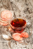 Homemade cookies cottage cheese with sugar and cup of hot tea Royalty Free Stock Photography