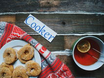 Homemade cookies and a cup of tea with a lemon on the table.  Royalty Free Stock Photos