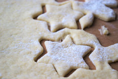 Homemade cookies cutters cake. Mum doing momemade cookies and cutting star cake Royalty Free Stock Photos