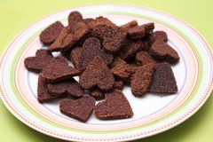 Homemade cookies for dogs with carob. Some fresh homemade cookies for dogs Royalty Free Stock Photography