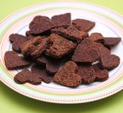 Homemade cookies for dogs with carob. Some fresh homemade cookies for dogs Royalty Free Stock Photo