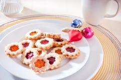 Homemade cookies for a festive coffee break. Homemade cookies and christmas decoration for a festive coffee break Stock Photography