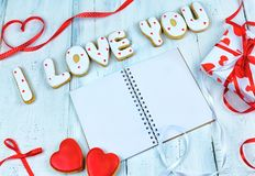 Homemade cookies in the form of a heart or I love you words as a gift to a beloved on Valentine`s Day. Stock Photography