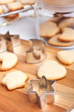 Homemade cookies with forms. Homemade cookies with farious cookie forms and some cookies in a glass jar Stock Photos