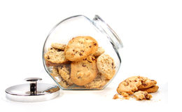 Homemade cookies in glass jar on white stock photos
