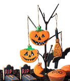 Homemade cookies for Halloween hanging on a tree on a white Royalty Free Stock Photo