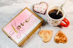 Homemade cookies,heart shape,black coffee and love present Stock Photos