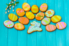 Homemade cookies with icing in the shape of an egg for Easter. Delicious Easter cookies on a blue background.  Cooki Royalty Free Stock Images