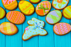 Homemade cookies with icing in the shape of an egg for Easter. Delicious Easter cookies on a blue background.  Cooki Stock Image