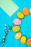 Homemade cookies with icing in the shape of an egg for Easter. Delicious Easter cookies on a blue background.  Cooki Royalty Free Stock Photos