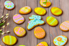 Homemade cookies with icing in the shape of an egg for Easter. Delicious Easter cookies on a brown background. Cooki Royalty Free Stock Images