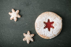 Homemade cookies with jam, shortbread on a black slate table. To Stock Photography