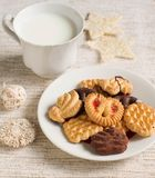 Homemade cookies and milk. Plate with tasty Christmas homemade cookies and milk Stock Photos