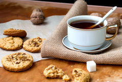 Homemade cookies and nuts with a cup of tea Stock Photos