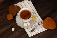 Homemade cookies and nuts with a cup of tea Royalty Free Stock Photography