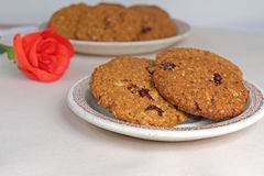 Homemade cookies oatmeal dried cranberries and red rose Stock Photo