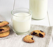 Homemade cookies and pieces with glass of milk on the table. Royalty Free Stock Photography