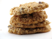 Homemade cookies in a pile. Pile of four homemade oatmeal cookies with chocolate chips on white.  Macro close-up Royalty Free Stock Images