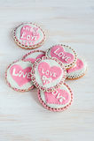Homemade cookies with pink frosting in the shape of hearts Royalty Free Stock Images