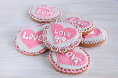 Homemade cookies with pink frosting in the shape of hearts Royalty Free Stock Photography