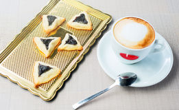 Homemade cookies with prunes. Lying on a tray next to a cup of coffee Stock Photos