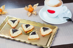 Homemade cookies with prunes. Lying on a tray next to a cup of coffee Royalty Free Stock Photography