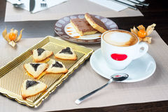 Homemade cookies with prunes. Lying on a tray next to a cup of coffee Royalty Free Stock Photo