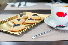 Homemade cookies with prunes. Lying on a tray next to a cup of coffee Stock Image