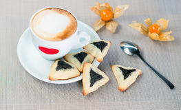 Homemade cookies with prunes. Lying on a tray next to a cup of coffee Stock Photo