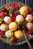 Homemade cookies with raspberries, blueberries, cherries and cur. Rants close-up on the table. vertical view from above Royalty Free Stock Photo