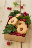 Homemade cookies with raspberry jam and fresh rasp Stock Images