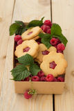 Homemade cookies with raspberry jam and fresh rasp Stock Photos